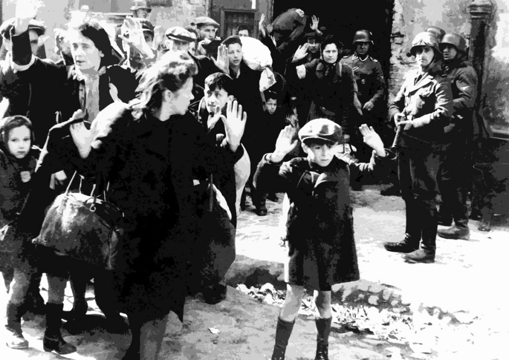 """Warsaw Ghetto Uprising. The original German caption reads: """"Forcibly pulled out of dug-outs."""" One of the most famous pictures of World War II"""