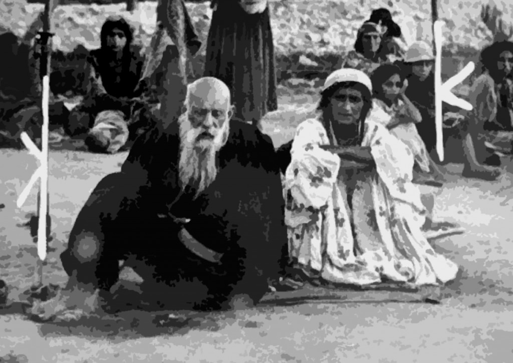Close-up of a Gypsy couple sitting in an open area in the Belzec concentration camp