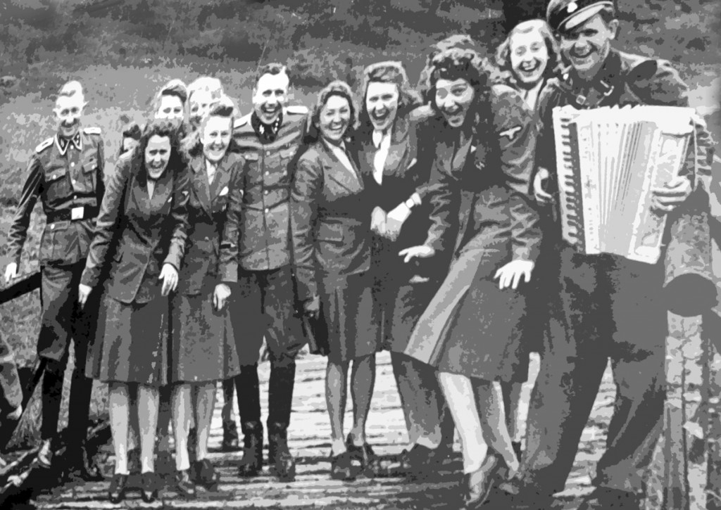 Nazi concentration camp guards of Auschwitz on a retreat not far from the camp at all. They are well aware of the horrors they are allowing to happen, and even causing, and look genuinely happy.