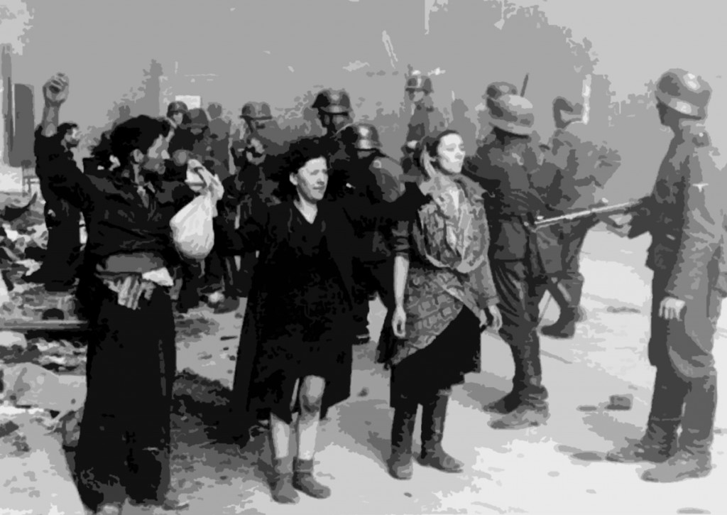 SS troops guard members of the Jewish resistance captured during the suppression of the Warsaw Ghetto Uprising