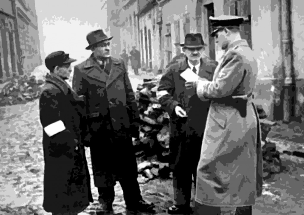A German policeman checks the identification papers of Jews in the Krakow ghetto