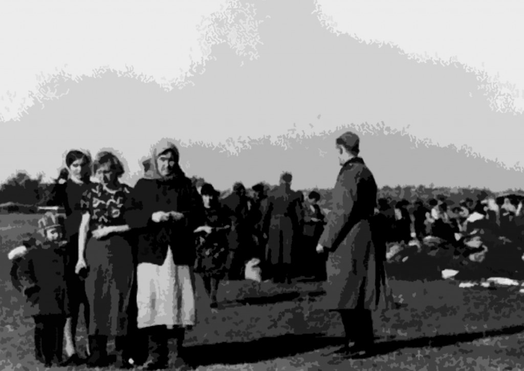 Jewish women and children who have already surrendered their belongings form a small group as others in the background are ordered to discard their outer clothing and their possessions prior to execution