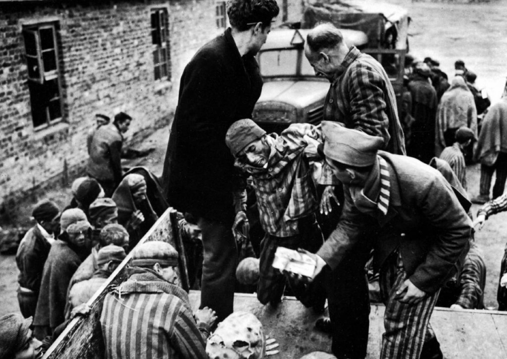 American soldiers liberating prisoners from the Nazi concentration camp at the end of WWII