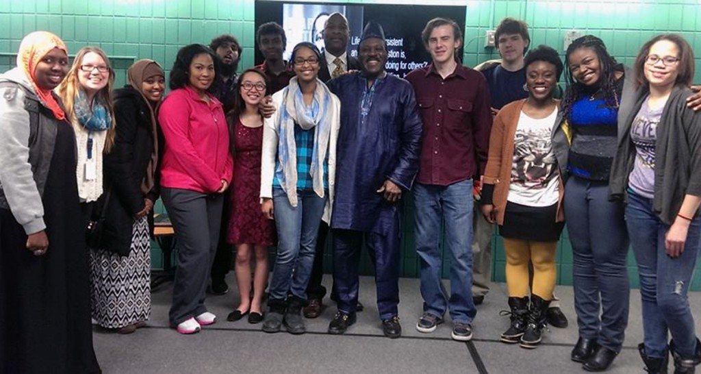 Sahra Mo'allin (center) with Civil Rights Activist Spike Moss on campus