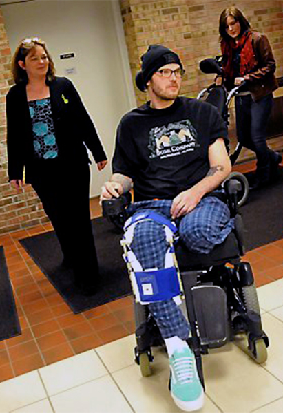 Zack Mohs with mom and sister Molly at Courage Center, 2013