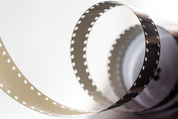 Photo of a reel of film unfurling