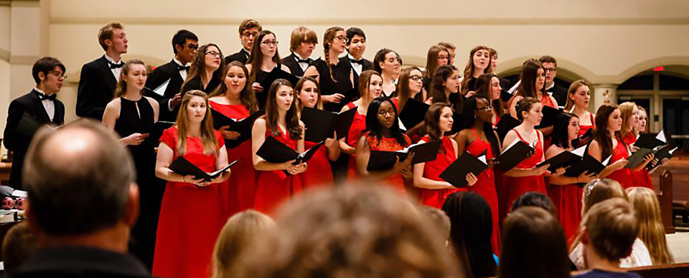 Maggie singing with Woodbury High choir