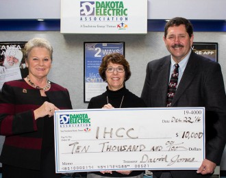 Margaret Schreiner, Dakota Electric director, Gail Morrison, Inver Hills Foundation executive director, and Clay Van De Bogart, Dakota Electric director