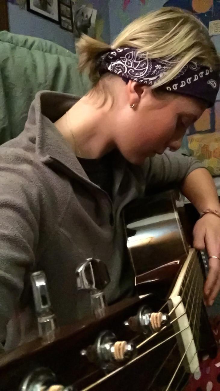 Kayla on guitar