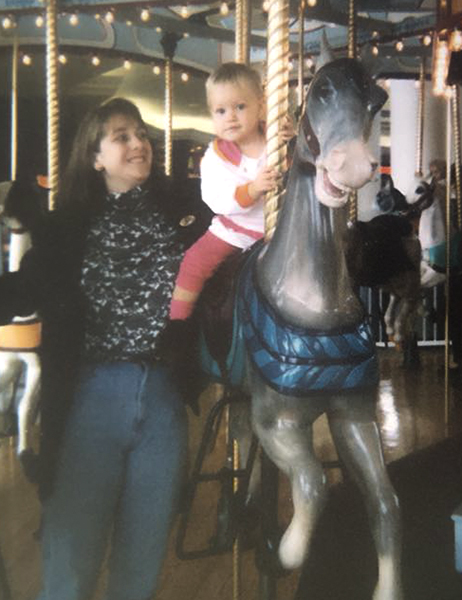 Age 1 on carousel with Mamabear