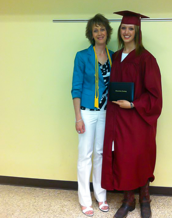 With her Mamabear at high school graduation wearing boots and spurs