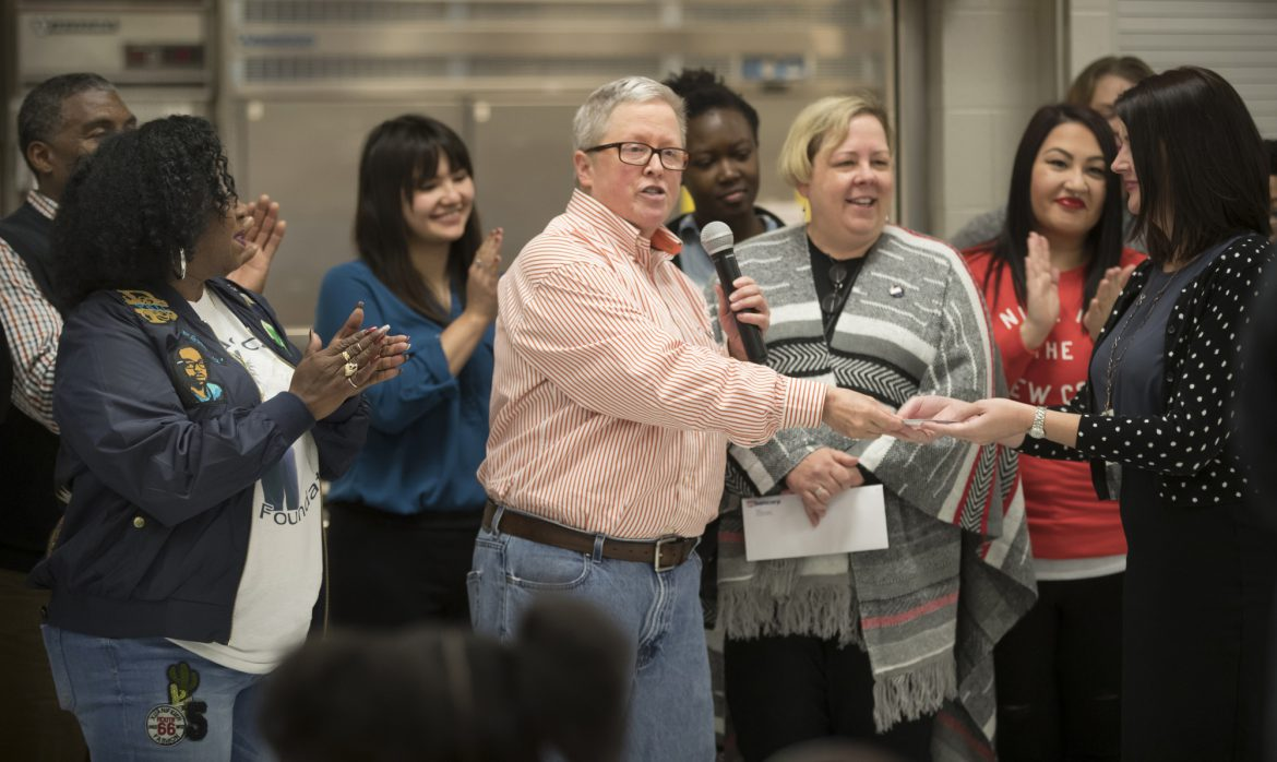 Pam Fergus presenting check at J.J. Hill_Renee Jones Schneider/ Star Tribune