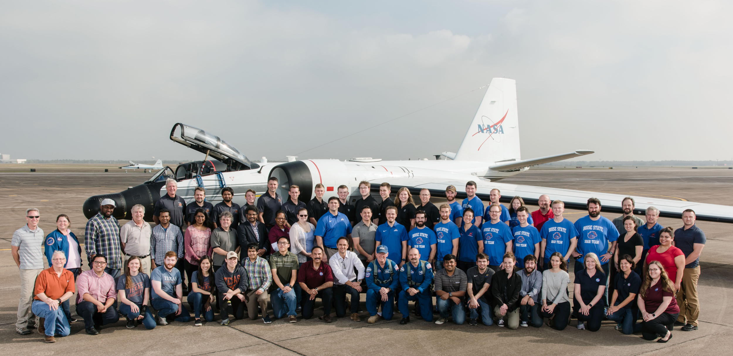 Sam with other students and a WB-57 at  Ellington Airport at JSC.
