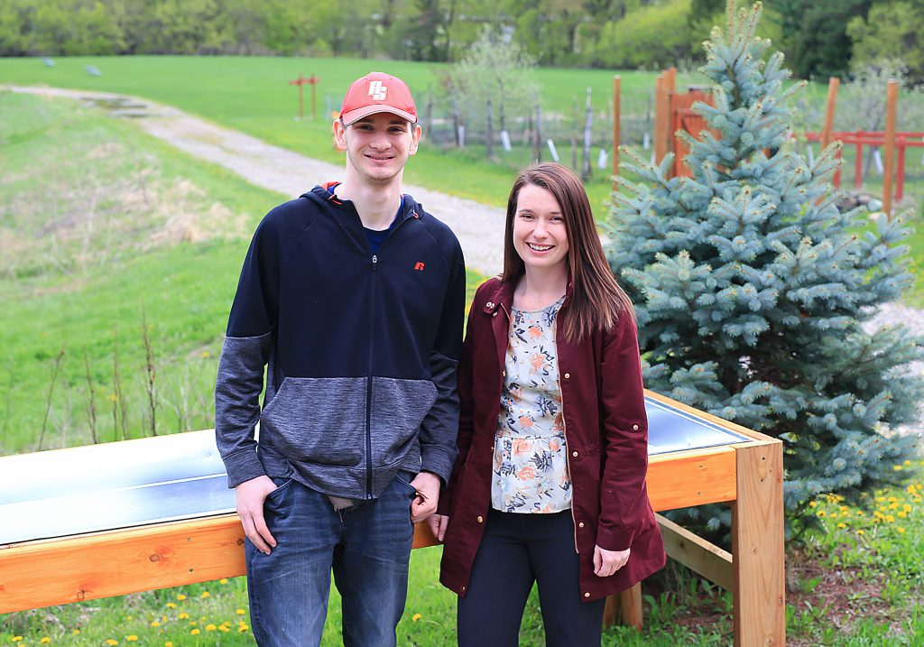 Brian and Randi by ADA-compliant raised garden bed