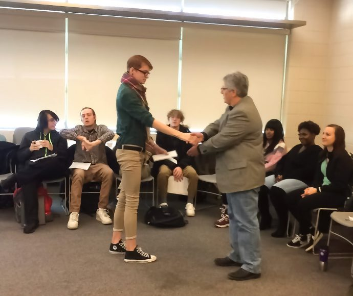 LCOM students presenting letters to Ampersand Families director