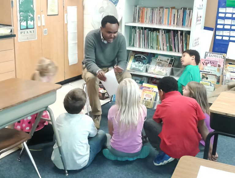 EAP LCOM students wrote folktales from their home culture and shared the tales with 2nd graders at Garlough Elementary School