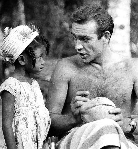Sean Connery signs coconut for young Jamaican girl on the set of Dr No | Near Oracabessa, Jamaica 1962