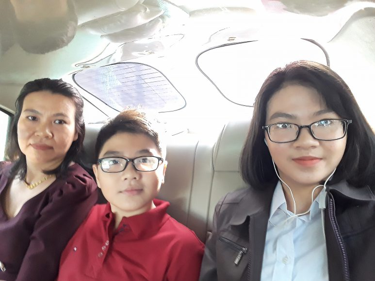 Thanh with mom and brother, Hoang