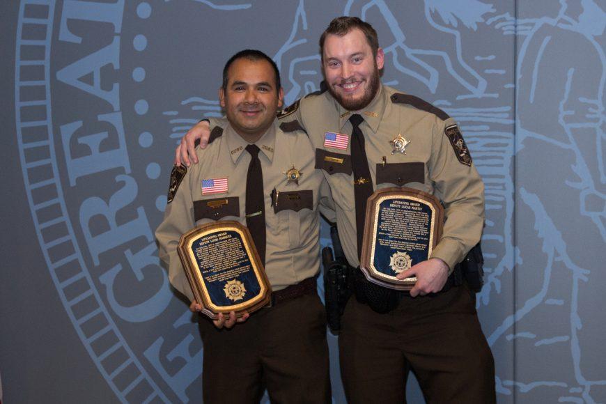 Deputy Lucio Marquez and Deputy Martin receiving Lifesaving Award